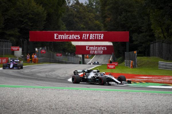 Valtteri Bottas, Mercedes AMG W10, leads Daniil Kvyat, Toro Rosso STR14