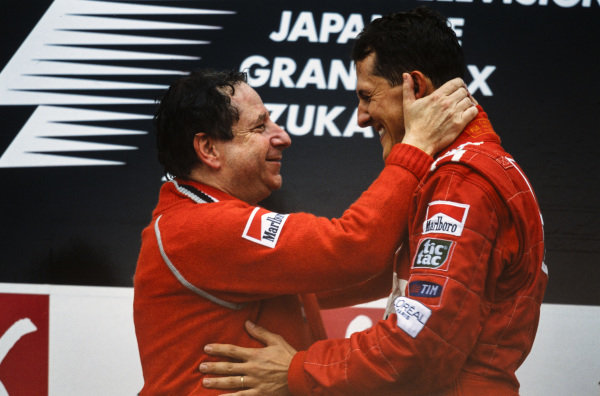 Jean Todt, Team Principal, Ferrari, and Michael Schumacher, 1st position, on the podium.