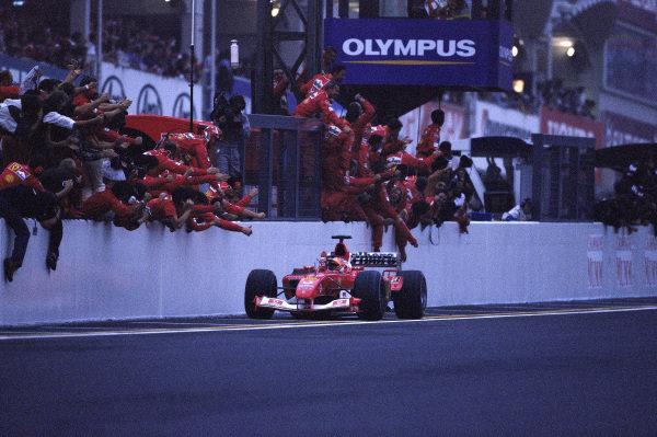 Rubens Barrichello, Ferrari F2003-GA, celebrates victory with the Ferrari team.