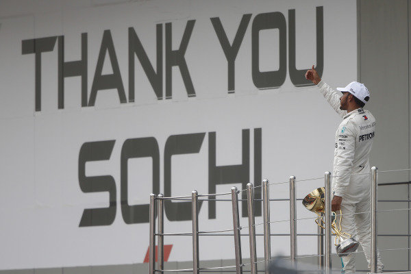 Lewis Hamilton, Mercedes AMG F1, 1st position, gives fans a thumbs up before leaving the podium