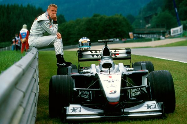 Race winner Mika Hakkinen(FIN) Mclaren  MP4/15 watches practice after stopping out on the circuit during practice. Austrian Grand Prix, A1 Ring, Austria, 16 July 2000. BEST IMAGE