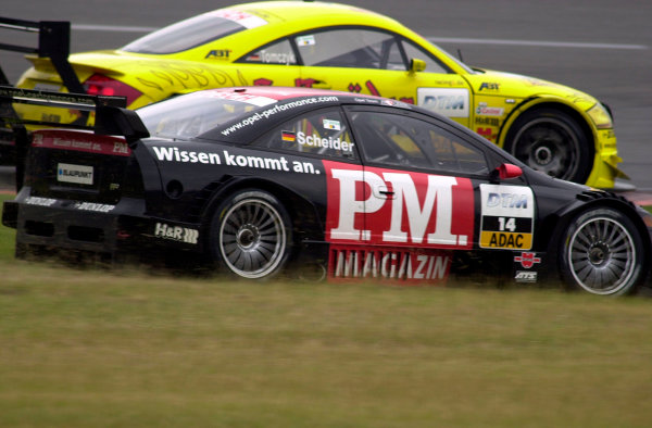 2002 DTM Championship Lausitzring, Germany. 12th - 14th July 2002.Timo Schneider (Holzer Opel 2002) battles with the Abt Audi TT-R of Martin Tomzyck, action.World Copyright: Andre Irlmeier/LAT Photographic ref: Digital Image Only