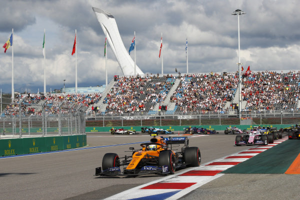 Lando Norris, McLaren MCL34, leads Sergio Perez, Racing Point RP19, Max Verstappen, Red Bull Racing RB15, Nico Hulkenberg, Renault R.S. 19, as behind, Antonio Giovinazzi, Alfa Romeo Racing C38, Romain Grosjean, Haas VF-19 and Daniel Ricciardo, Renault R.S.19 collide