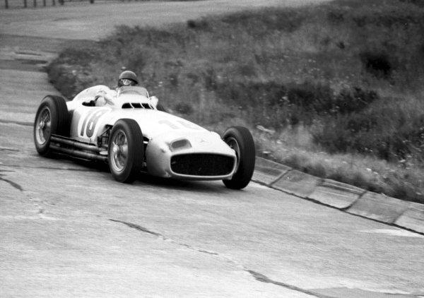 1954 German Grand Prix.Nurburgring, Germany. 30/7-1/8 1954.Juan Manuel Fangio (Mercedes-Benz W196) 1st position.World Copyright - LAT Photographic