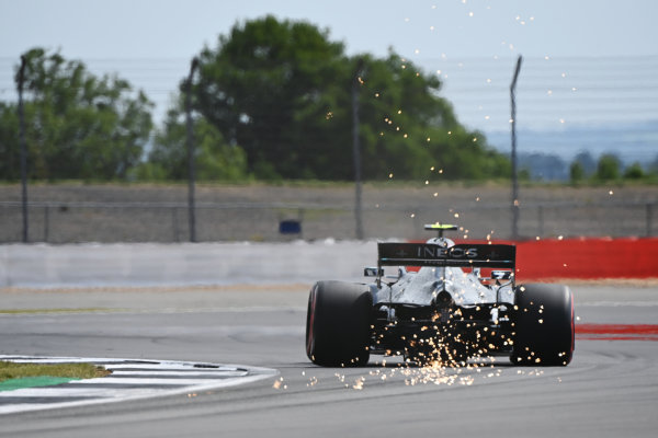 Sparks fly from the rear of Valtteri Bottas, Mercedes F1 W11 EQ Performance
