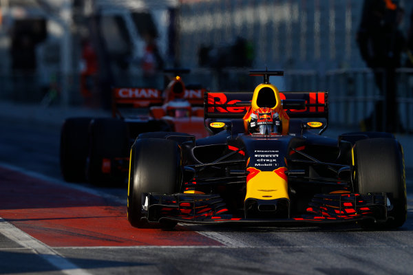 Circuit de Barcelona Catalunya, Barcelona, Spain. Thursday 02 March 2017. Max Verstappen, Red Bull Racing RB13 TAG Heuer, exits the pit lane ahead of Stoffel Vandoorne, McLaren MCL32 Honda.  World Copyright: Steven Tee/LAT Images ref: Digital Image _R3I7291