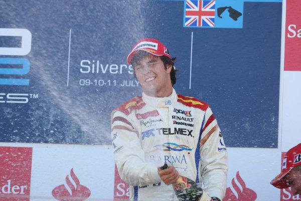 Silverstone, England. 11th July.Sunday Race. Sergio Perez (MEX, Barwa Addax Team) celebrates his victory on the podium. Photo: Jakob Ebrey/GP2 Media Service.Ref: _MKO_9468 jpg