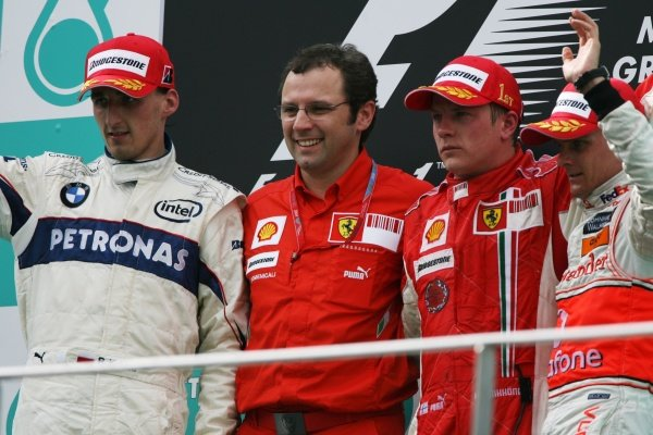 The podium (L to R): Robert Kubica (POL) BMW Sauber F1, second; Stefano Domenicali (ITA) Ferrari Manager of F1 Operations; Kimi Raikkonen (FIN) Ferrari, race winner; Heikki Kovalainen (FIN) McLaren, third.