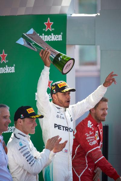 Autodromo Nazionale di Monza, Italy. Sunday 3 September 2017. Valtteri Bottas, Mercedes AMG, 2nd Position, applauds as Lewis Hamilton, Mercedes AMG, 1st Position, raises the winners trophy. World Copyright: Steve Etherington/LAT Images  ref: Digital Image SNE14507