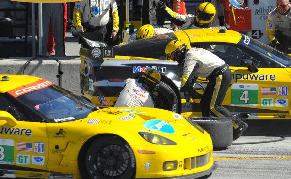 16-18 September, 2011, Monterey, California USA#4 Corvette Racing Chevy Corvette C6 ZR1 pitstop as #3 Corvette exits their pitbox.(c)2011,  Dan R. Boyd  LAT Photo USA