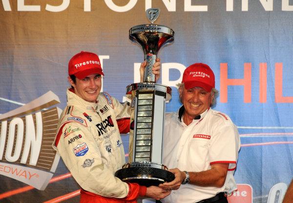 8-9 October, 2009, Homestead, Florida USAJ R. Hildebrand accepts his Firestone Indy Lights Championship trophy from Joe Barbieri of Firestone©2009, Paul Webb, USALAT Photographic