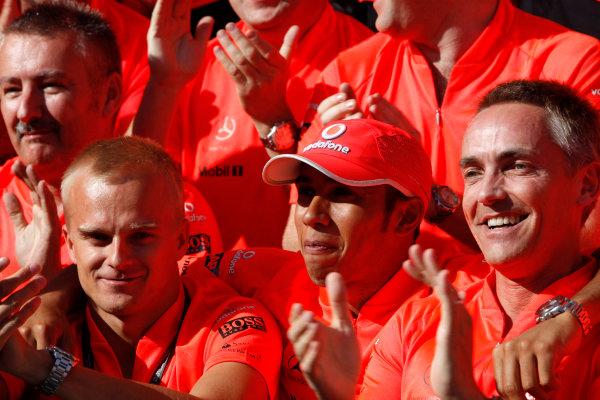Hungaroring, Budapest, Hungary26th July 2009Heikki Kovalainen, McLaren MP4-24 Mercedes, 5th position, Lewis Hamilton, McLaren MP4-24 Mercedes, 1st position, and Martin Whitmarsh, Team Principal, McLaren Mercedes, celebrate victory with the McLaren team. Portrait. World Copyright: Glenn Dunbar/LAT Photographicref: Digital Image GD5D9866