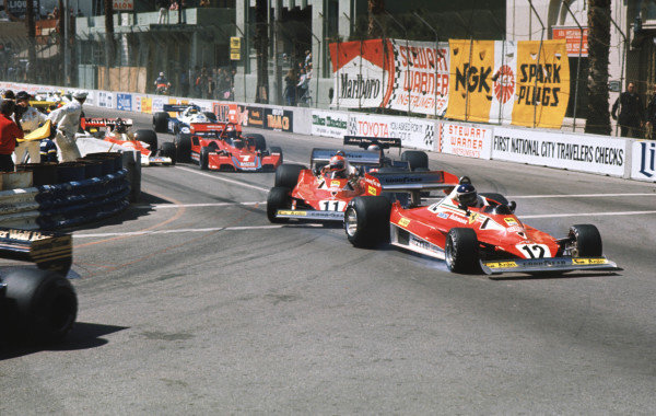 1977 United States Grand Prix West.Long Beach, California, USA.1-3 April 1977.As Jody Scheckter's Wolf exits Cooks Corner on the first lap, Carlos Reutemann (Ferrari 312T2) locks up under braking and goes straight-on. This caused a fracas behind as Niki Lauda (Ferrari 312T2) and Mario Andretti (Lotus 78 Ford) lift off completely to tuck inside, resulting in a chain reaction of collisions behind. World Copyright - LAT Photographic