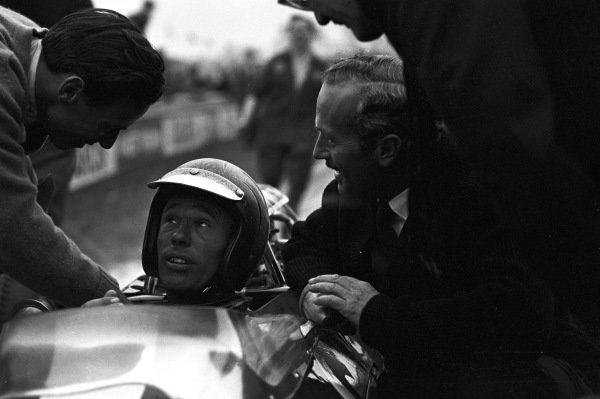 Mike Spence is congratulated by Colin Chapman and Jim Clark.