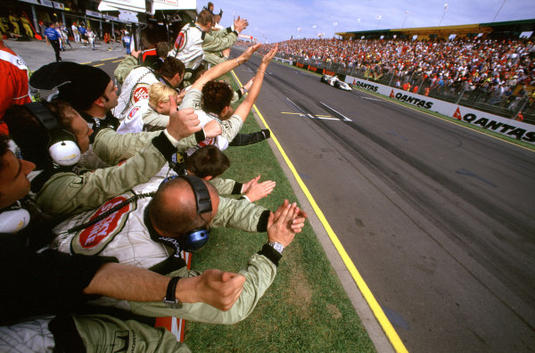 Australian Grand Prix.Albert Park, Melbourne, Australia. 2-4 March 2001.The B.A R. Honda team cheer as Olivier Panis finishes in 4th position, prior to being penalised and put back to 7th position for overtaking under yellow flags.World Copyright - Steven Tee/LAT Photographic ref: 35mm Image Aus A21