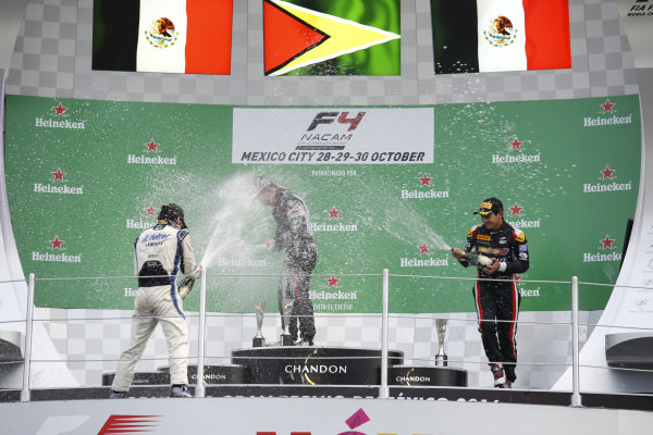 Jose Sierra (MEX) RPL1 RACING TEAM, Race winner Calving Ming (GUY) RAM 1 RACING TEAM and Alexis Carreno (MEX) MARTIGA EG RACING TEAM celebrate on the podium with the champagne at Formula 4 Series, Circuit Hermanos Rodriguez, Mexico City, Mexico, 30 October 2016.