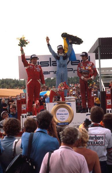 1977 Swedish Grand Prix.Anderstorp, Sweden.17-19 June 1977.Jacques Laffite (Ligier Matra) 1st position, Jochen Mass (McLaren Ford) 2nd position and Carlos Reutemann (Ferrari) 3rd position on the podium.Ref-77 SWE 06.World Copyright - LAT Photographic