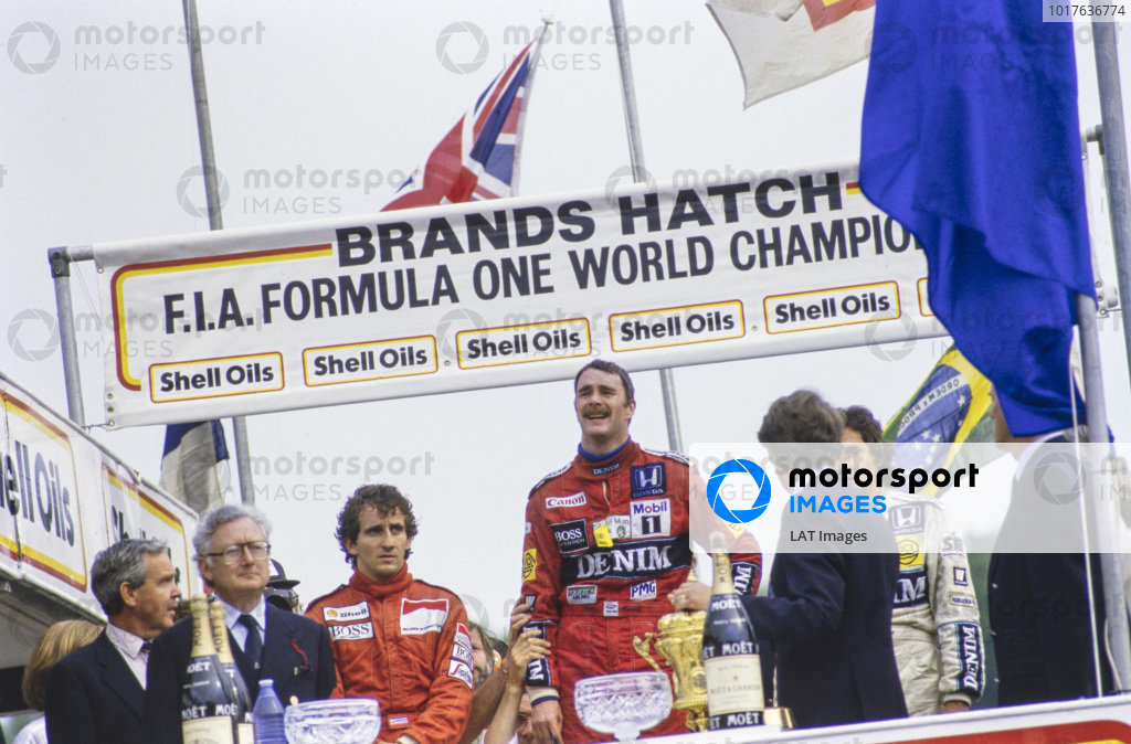 Nigel Mansell, 1st position, Nelson Piquet, 2nd position, and Alain Prost, 3rd position, on the podium.