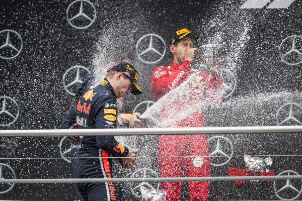 Race winner Max Verstappen, Red Bull Racing and Sebastian Vettel, Ferrari celebrates on the podium with the champagne
