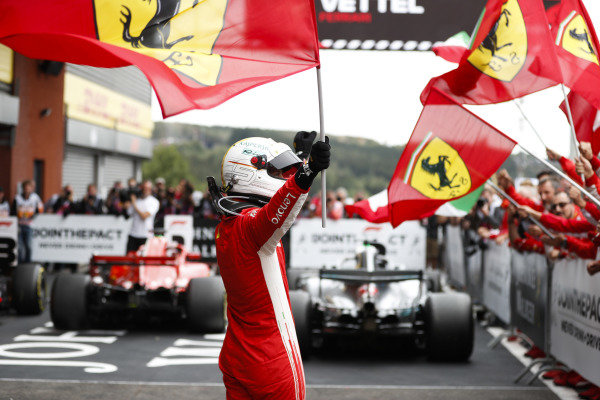 Sebastian Vettel, Ferrari, celebrates victory in parc ferme.