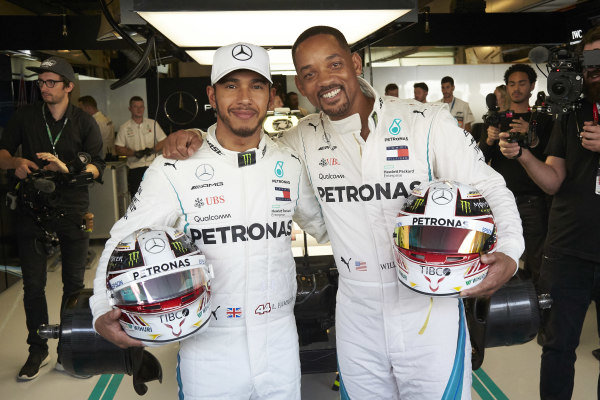 Lewis Hamilton, Mercedes AMG F1 and Will Smith pose in the Mercedes garage