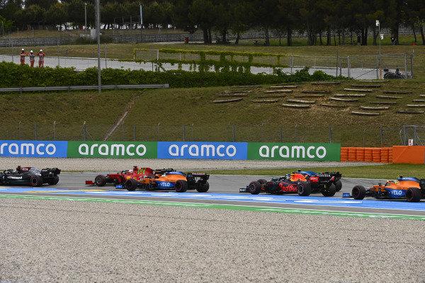 Valtteri Bottas, Mercedes W12, leads Charles Leclerc, Ferrari SF21, Daniel Ricciardo, McLaren MCL35M, Esteban Ocon, Alpine A521, Sergio Perez, Red Bull Racing RB16B, and Lando Norris, McLaren MCL35M