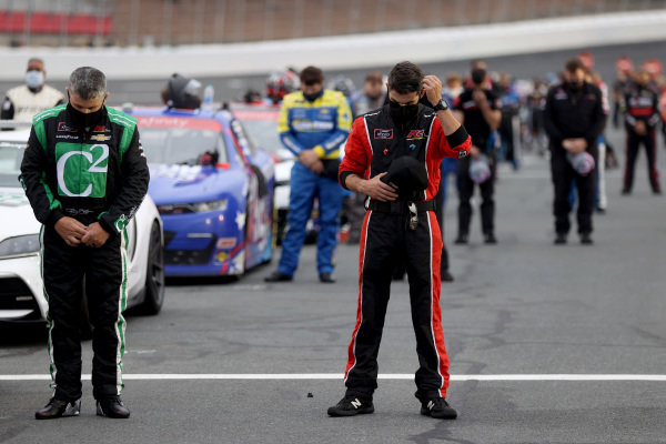 Drivers and crew stand for the national anthem, Copyright: Chris Graythen/Getty Images.