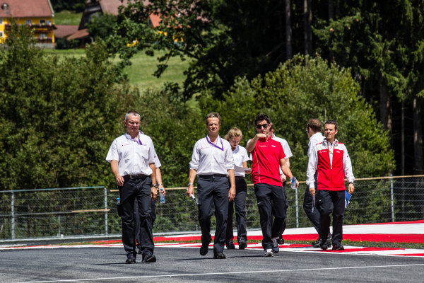 Mike Rockenfeller, Audi Sport Team Phoenix Audi RS 5 DTM walks the track with his team