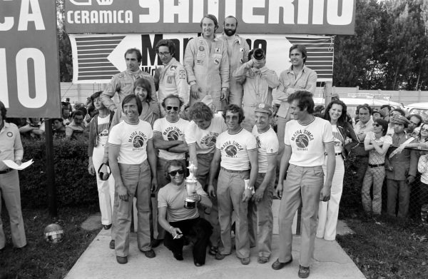 Members of the Matra-Simca team celebrate with winners Gérard Larrousse and Henri Pescarolo at the podium. Rolf Stommelen and Carlos Reutemann, 2nd position, and Andrea de Adamich and Carlo Facetti, 3rd position, share the podium.
