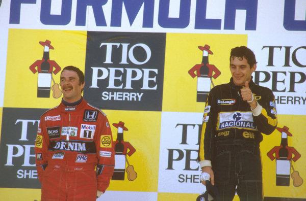Jerez, Spain.11-13 April 1986.Ayrton Senna (Team Lotus) 1st position and Nigel Mansell (Williams Honda) 2nd position on the podium.Ref-86 ESP 15.World Copyright - LAT Photographic