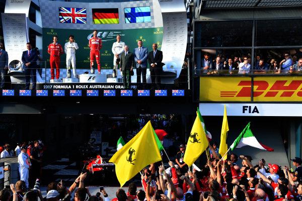 (L to R): Lewis Hamilton (GBR) Mercedes AMG F1, Luigi Fraboni (ITA) Ferrari Head of Engine Trackside Operations, race winner Sebastian Vettel (GER) Ferrari and Valtteri Bottas (FIN) Mercedes AMG F1 on the podium at Formula One World Championship, Rd1, Australian Grand Prix, Race, Albert Park, Melbourne, Australia, Sunday 26 March 2017. BEST IMAGE