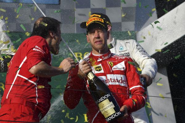 Race winner Sebastian Vettel (GER) Ferrari celebrates on the podium with the champagne at Formula One World Championship, Rd1, Australian Grand Prix, Race, Albert Park, Melbourne, Australia, Sunday 26 March 2017.