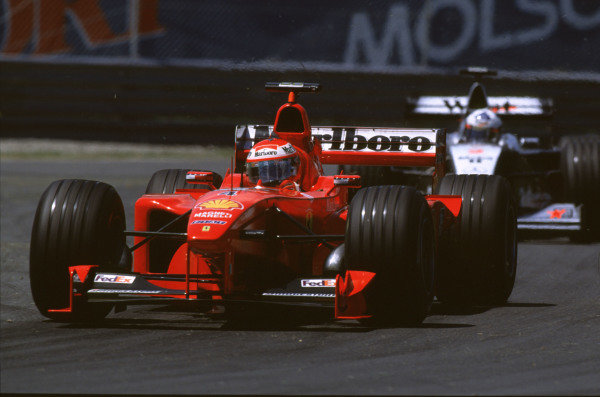 1999 Canadian Grand Prix.Montreal, Quebec, Canada.11-13 June 1999.Eddie Irvine (Ferrari F399) followed by David Coulthard (McLaren MP4/14 Mercedes).Ref-99 CAN 13.World Copyright - LAT Photographic