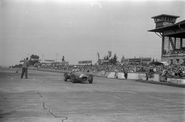 Giuseppe Farina, Ferrari 500, crosses the line and takes the chequered flag.