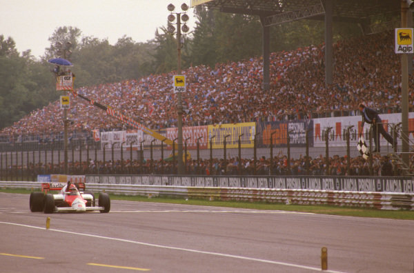 Monza, Italy.7-9 September 1984.Niki Lauda (McLaren MP4\2 TAG Porsche) takes the chequered flag for win.Ref-84 ITA 01.World Copyright - LAT Photographic