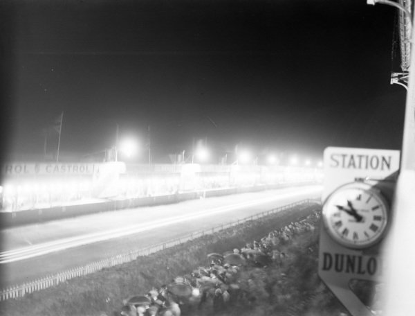 Fans watch as the action continues during the night.