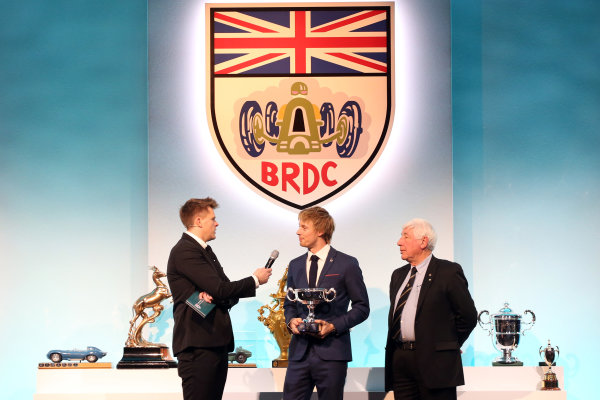 2017 British Racing Drivers Club Awards. London Hilton Hotel, Park Lane, London. Monday 4th December 2017. Jake Humphrey, Brendon Hartley and Howden Ganley. World Copyright: Jakob Ebrey / LAT Images. Ref: Hartley_06