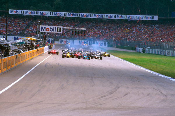 Hockenheim, Germany.25-27 July 1997.Gerhard Berger (Benetton B197 Renault) leads the grid away at the start from pole. Ref-97 GER 11.World Copyright - LAT Photographic