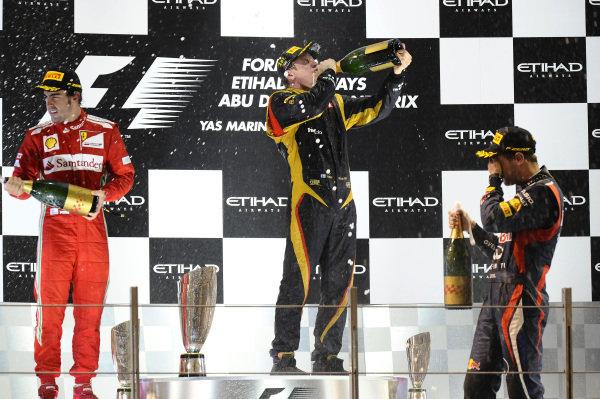 (L to R): Eric Boullier (FRA) Lotus F1 Team Principal, Fernando Alonso (ESP) Ferrari, race winner Kimi Raikkonen (FIN) Lotus F1 and Sebastian Vettel (GER) Red Bull Racing celebrates on the podium.Formula One World Championship, Rd18, Abu Dhabi Grand Prix, Race, Yas Marina Circuit, Abu Dhabi, UAE, Sunday 4 November 2012. BEST IMAGE