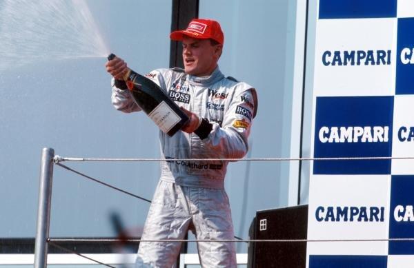 Race winner David Coulthard (GBR) McLaren celebrates on the podium. Formula One World Championship, Rd4, San Marino Grand Prix, Imola, Italy, 26 April 1998. BEST IMAGE