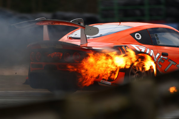 2013 Avon Tyres British GT Championship, Oulton Park, Cheshire. 30th March - 1st April 2013. Colin White CWS Ginetta G55 GT3 catches fire in Race 2. World Copyright: Ebrey / LAT Photographic.