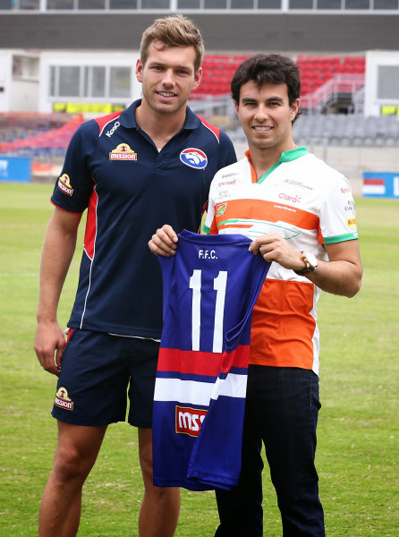 Nico Hulkenberg (GER) Force India F1 and Sergio Perez (MEX) Force India F1 with AFL Premiership Western Bulldogs at Whitten Oval.Formula One World Championship, Rd1, Australian Grand Prix, Preparations, Albert Park, Melbourne, Australia, Tuesday 11 March 2014.
