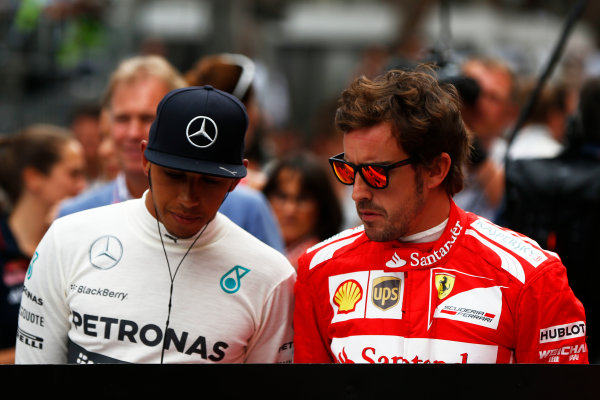 Monte Carlo, Monaco. Sunday 25 May 2014. Lewis Hamilton, Mercedes AMG, with Fernando Alonso, Ferrari. World Copyright: Andy Hone/LAT Photographic. ref: Digital Image _ONZ6912