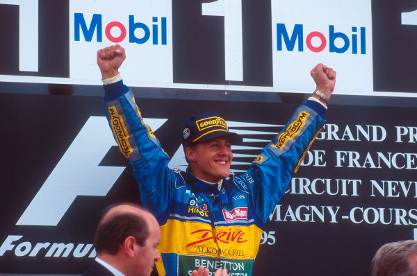Magny-Cours, France.30/6-2/7 1995.Michael Schumacher (Benetton Renault) celebrates 1st position on the podium.Ref-95 FRA 04.World Copyright - LAT Photographic