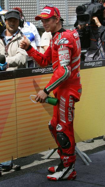 TT Circuit Assen, Netherlands. 28th June 2008.MotoGP Race.Casey Stoner Ducati Marlboro Team gives the thumbs up after his win.World Copyright: Martin Heath / LAT Photographicref: Digital Image Only