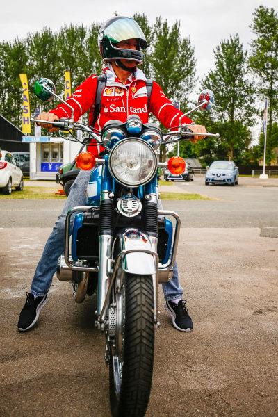 Silverstone, Northamptonshire, UK.  Thursday 13 July 2017. Sebastian Vettel, Ferrari, arrives on his motorcycle. World Copyright: Andy Hone/LAT Images  ref: Digital Image _ONZ2820