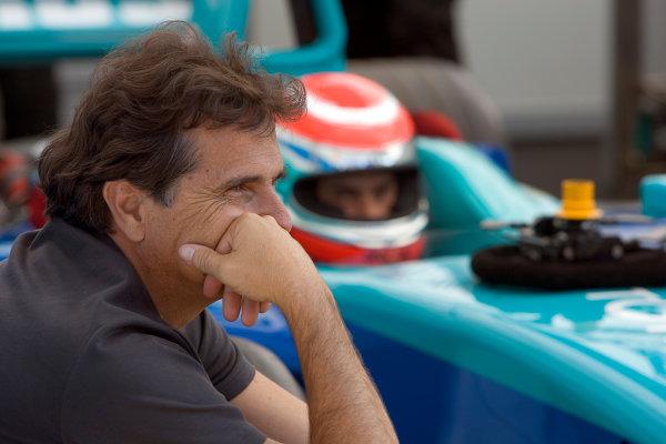 2005 GP2 Series - ImolaAutodromo Enzo e Dino Ferrari, Italy. 21st - 24th April.Thursday Preview.Nelson Piquet Sr. looks on as son Nelson Piquet Jr. (BR, Hitech Piquet Racing) gets comfortable in his car. Portrait.Photo: GP2 Series Media Serviceref: Digital Image Only.