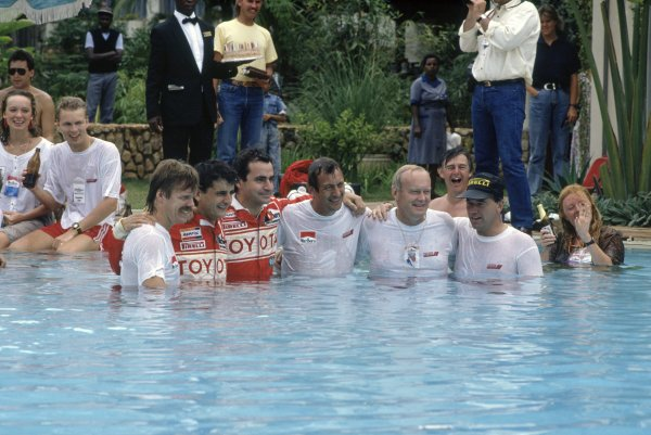 1990 World Rally Championship.Safari Rally, Kenya. 11-16 April 1990.Toyota team celebrate including Luis Moya, Carlos Sainz, Bjorn Waldegaard, Fred Gallagher in the swimming pool.World Copyright: LAT PhotographicRef: 35mm transparency 90RALLY10