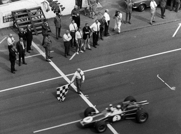 1967 French Grand Prix.Le Mans-Bugatti, France. 2 July 1967.Jack Brabham, Brabham BT24-Repco, 1st position, at the finish, action.World Copyright: LAT PhotographicRef: b&w print
