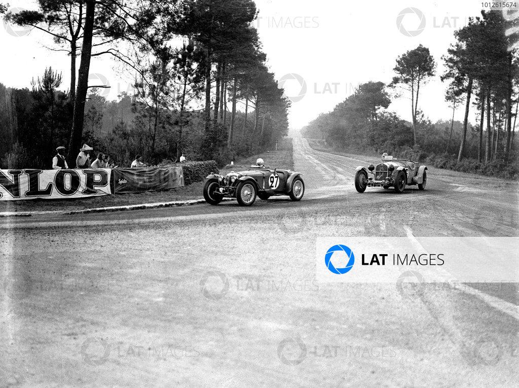 Le Mans, France. 16-17 June 1934.Jean Sebilleau/Georges Delaroche (Riley Nine MPH Racing, 2nd position) leads Earl Howe/Tim Rose-Richards (Alfa Romeo 8C).Ref-Motor 800/74.World Copyright - LAT Photographic